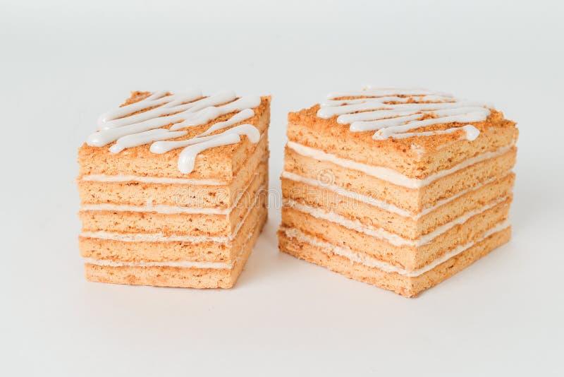 Plasterek płatowaty miodowy tort odizolowywający fotografia royalty free