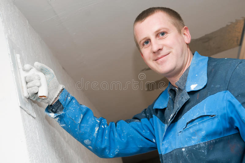 Plasterer bei der Arbeit lizenzfreies stockbild