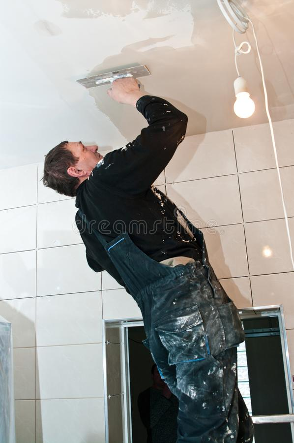Plasterer at ceiling work, home renovation concept royalty free stock photos