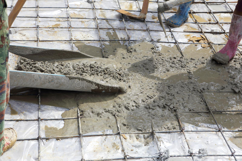 A plasterer concrete worker at floor work royalty free stock images