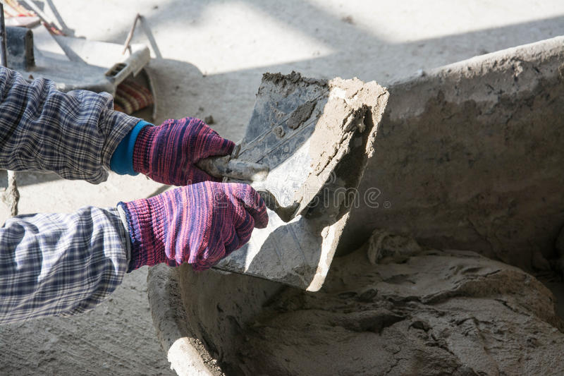 Plasterer concrete worker at wall of house construction royalty free stock images