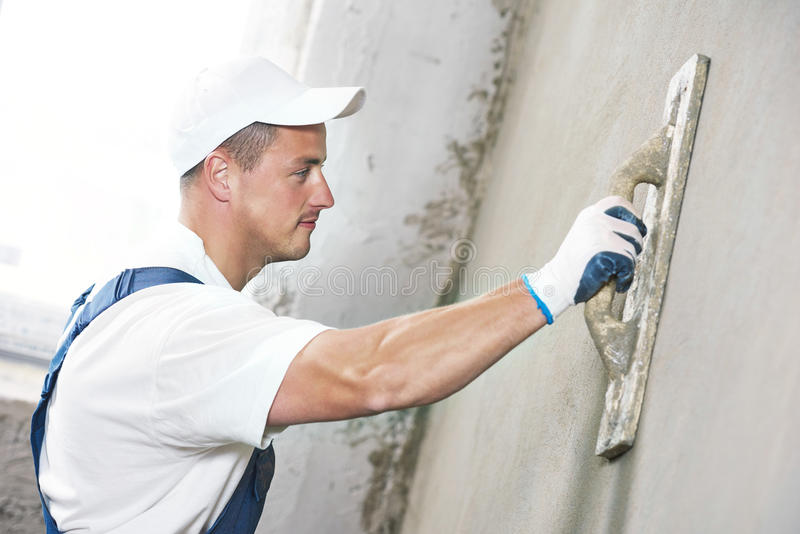 Plasterer at indoor wall renovation royalty free stock photography