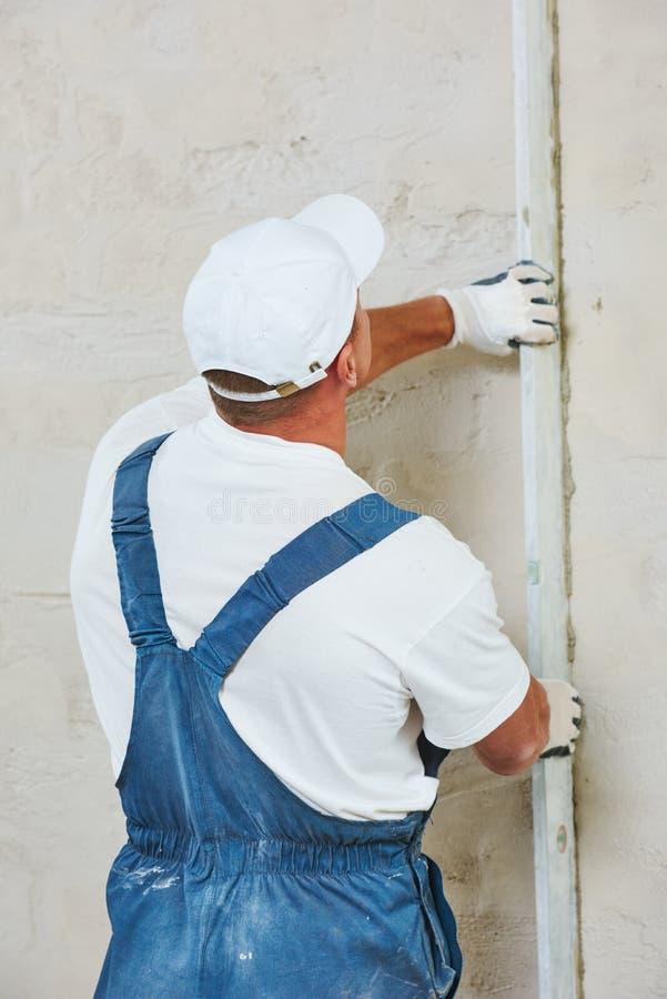 Plasterer at indoor wall renovation royalty free stock image