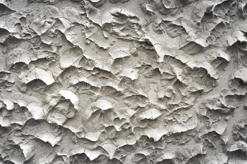 Plastering of gray  cement wall in seamless rough embossed patterns texture abstract for background royalty free stock images