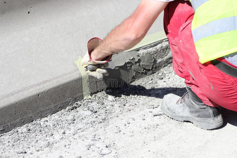 Plastering holes royalty free stock photography