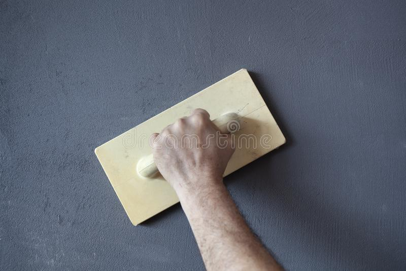 Plastering and Smoothing of a Wall royalty free stock images