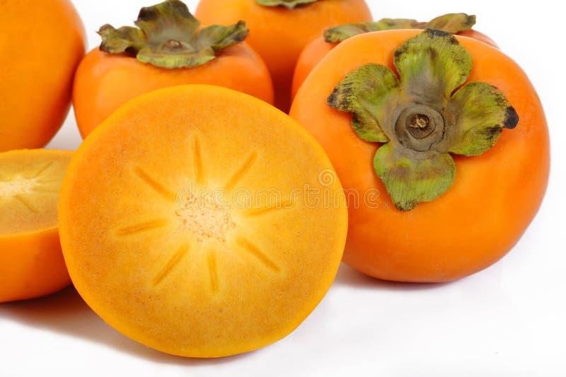 Plasterka persimmon owoc na białym tle zdjęcie stock