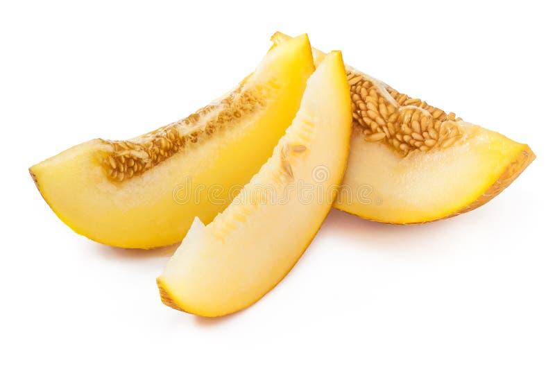 Plasterki cukierki, dojrzały żółty melon z ziarnami Odizolowywający na bielu zdjęcia stock