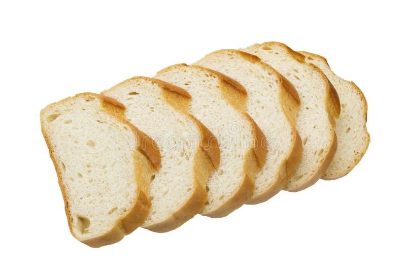 Plasterki odizolowywający na białym tle biały chleb obraz stock