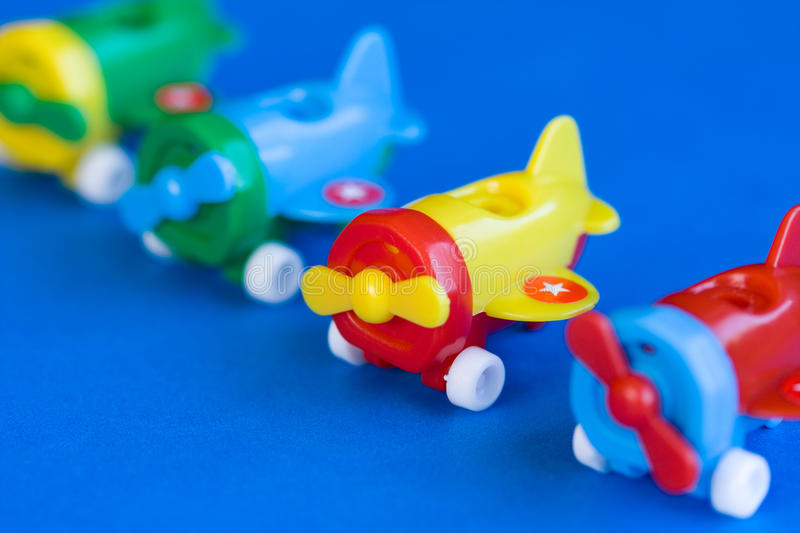 Plastic airplane toy. Plastic airplane model toy on blue background royalty free stock image