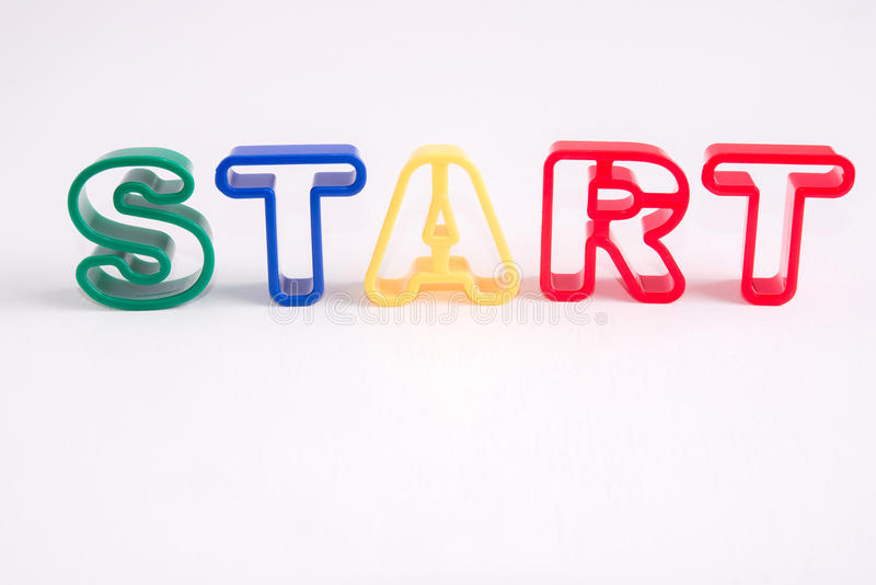 Plastic alphabet on white background with word start stock image