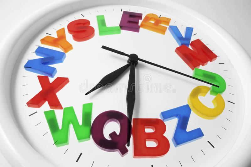 Plastic Alphabets on Wall Clock royalty free stock images