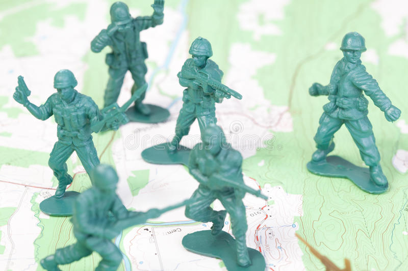 Download Plastic Army Men Fighting On Topographic Map. Stock Photo - Image: 18451768