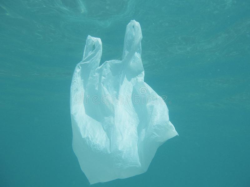 Plastic bag floating into the sea. Polluted enviromental. Recycle. Garbage royalty free stock photography