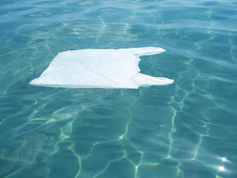 Plastic bag floating into the sea. Polluted environmental. Recycle. Garbage stock photos