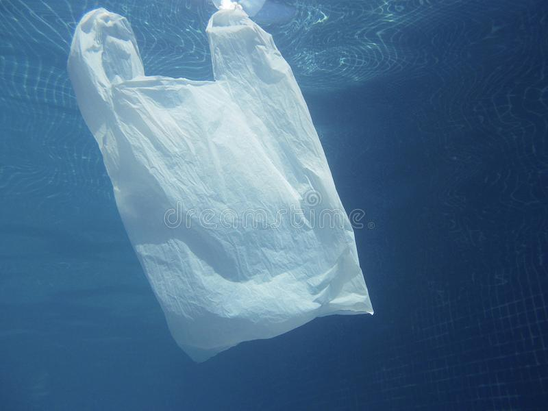 Plastic bag floating into the water. Polluted enviromental. Recycle. Garbage stock photos