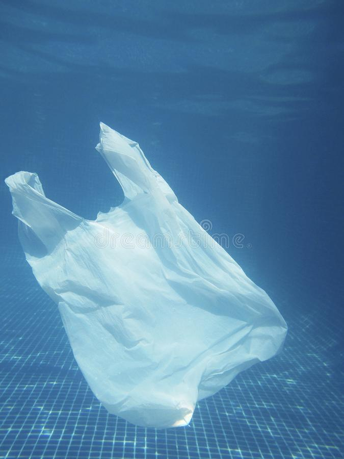 Plastic bag floating into the water. Polluted enviromental. Recycling. Plastic bag floating into the water. Polluted enviromental. Recycle garbage stock image