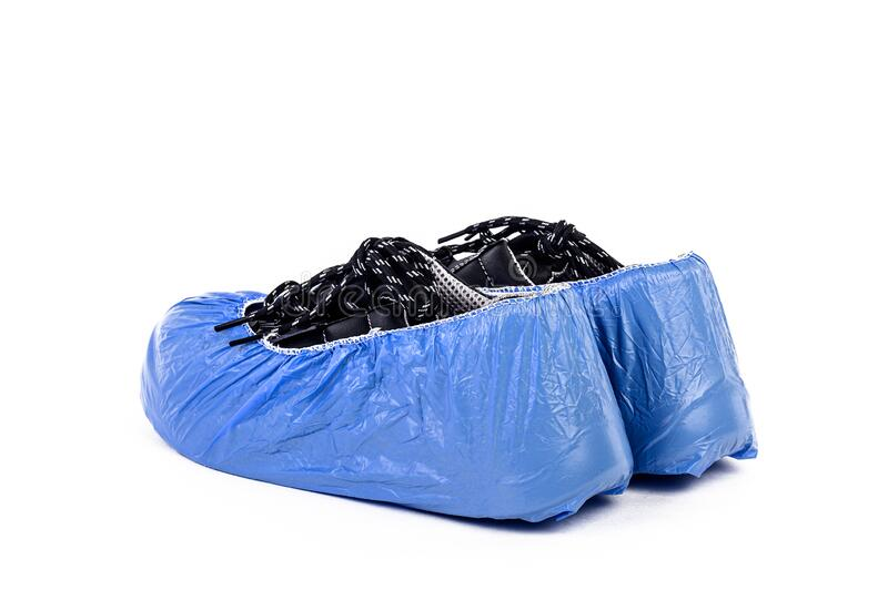 The Plastic bag for shoe to protect covid, covid 19, corona, fever, flu and surgery operation to avoid virus, dirty and keep clean. The Plastic bag for shoe to stock photo