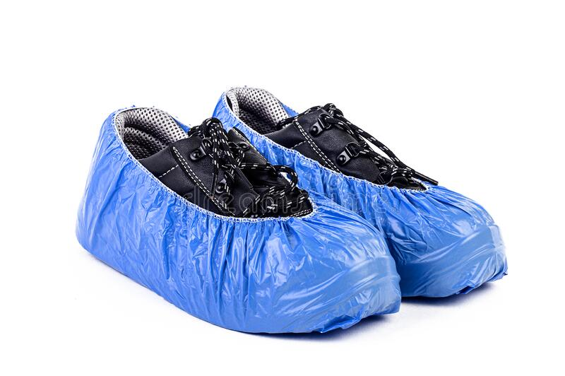 The Plastic bag for shoe to protect covid, covid 19, corona, fever, flu and surgery operation to avoid virus, dirty and keep clean. The Plastic bag for shoe to stock photos