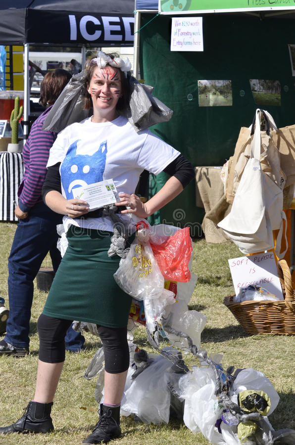 Plastic bags pollution endangering planet and marine life in oceans. A brave woman in a crazy but thought provoking fancy dress costume made out of single use stock images