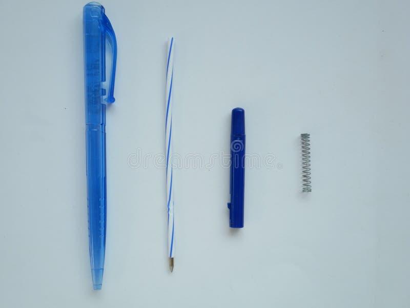 Plastic ballpoint pen. Spring. Ballpoint pen piece part. Ballpoint pen fixture. Pen detail and inside. stock photo