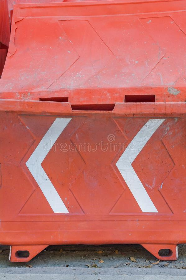 Plastic barrier in orange color used as a safety signal during c royalty free stock image