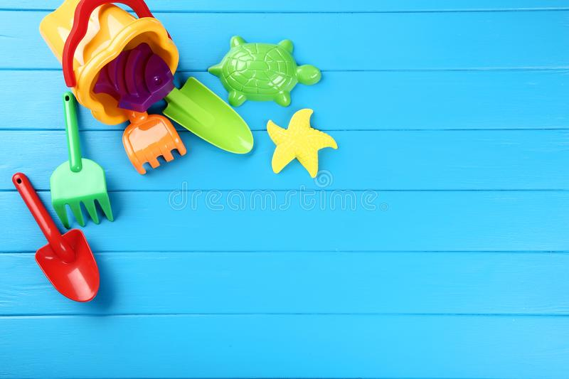 Plastic beach toys. On blue wooden table royalty free stock photography