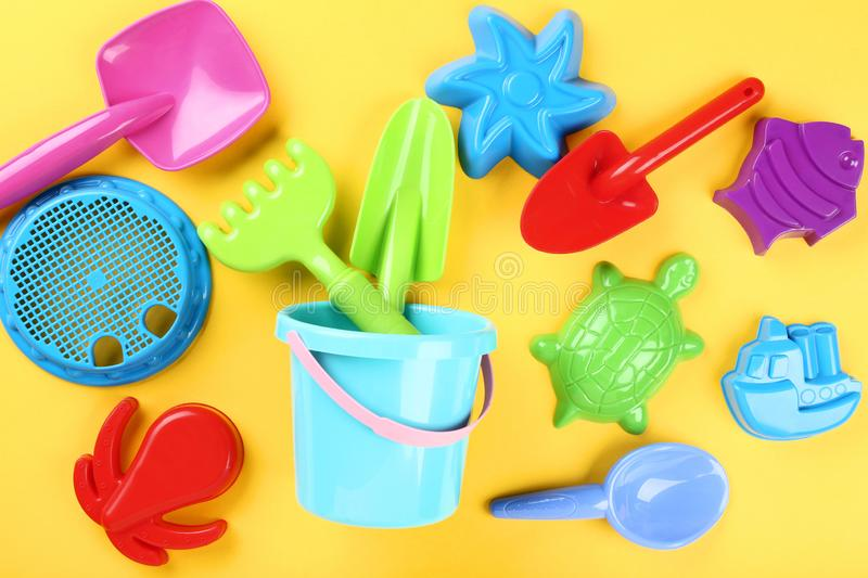 Plastic beach toys. On yellow background royalty free stock image