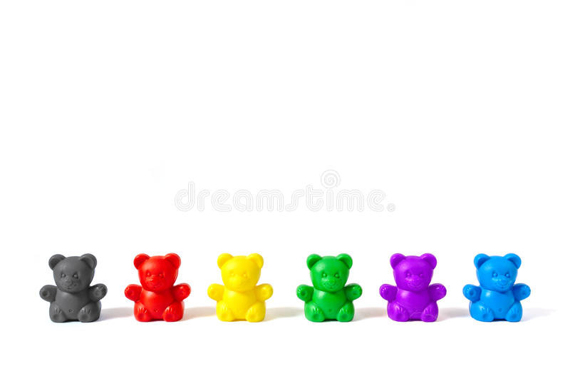 Plastic bear figures in the colors of Germany`s major political parties, on white background. Six plastic bear figures in the colors of Germany`s major political stock photography