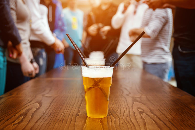 Plastic beer glass with Tubules stock photography