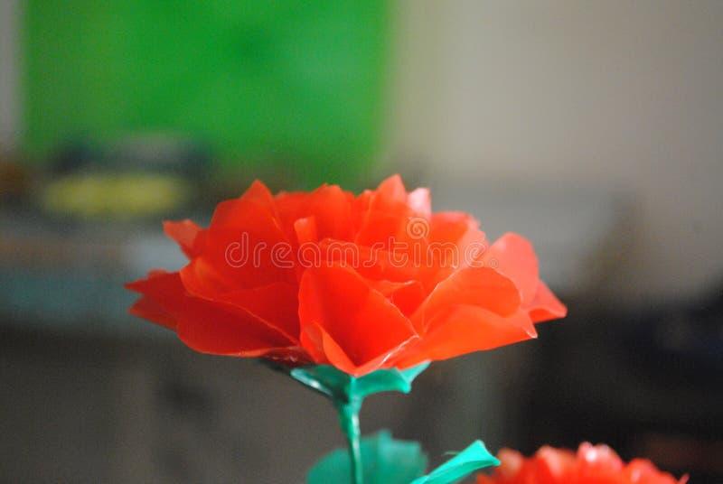 Plastic bloem stock afbeeldingen