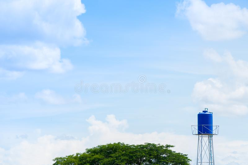 A plastic blue water tank on the tower royalty free stock image