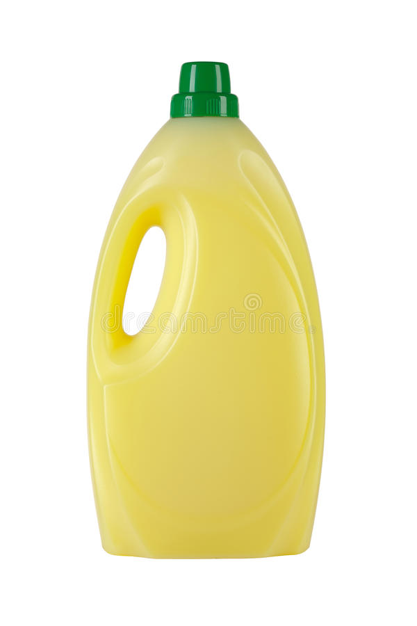 Plastic bottle. With yellow liquid and green cap royalty free stock photos