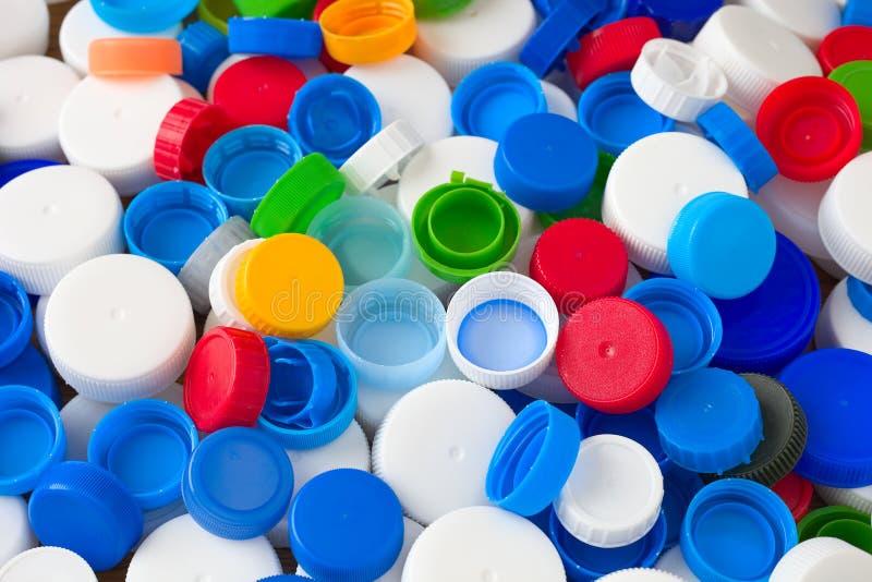 Plastic bottle caps. Background of blue, white, red, green plastic bottle caps royalty free stock image