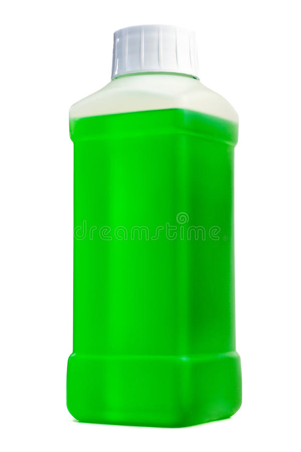Plastic bottle with cleaning liquid. Transparent plastic bottle with green cleaning liquid. Standing vertical royalty free stock image