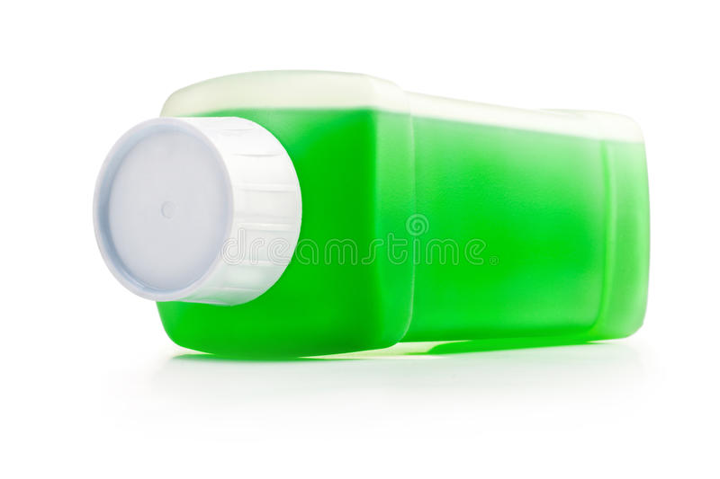 Plastic bottle with cleaning liquid. Transparent plastic bottle with green cleaning liquid. Lying horizontal stock photography