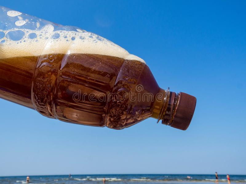 Plastic bottle of drink, blue sky, global environment conservation concept stock photos