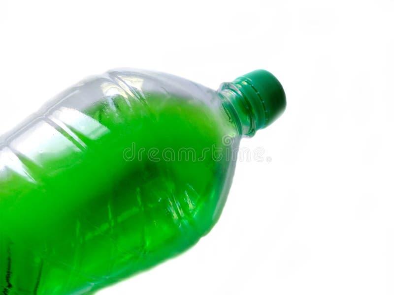 Plastic bottle. Capacity for liquid. Plastic bottle with a drink. Capacity for liquid royalty free stock photo
