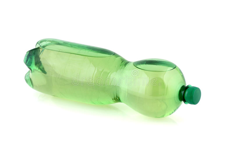 Plastic bottle with drinking water. Green plastic bottle with drinking water lying isolated on white after stock photography