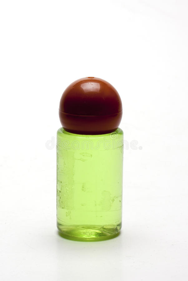 Plastic bottle with green liquid. On white background// isolated objects stock photo
