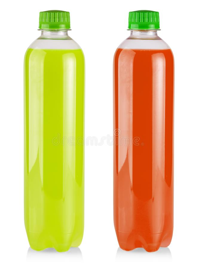 The plastic bottle with green and red  juice on white. Plastic bottle with green and red  juice on white royalty free stock images