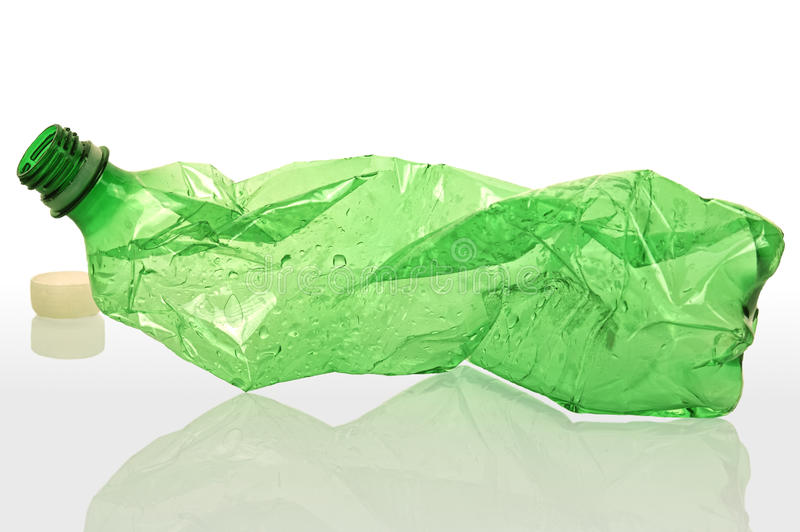 Plastic Bottle. The image shows a green plastic bottle over white reflective background stock photography