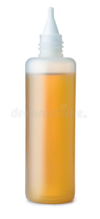 Plastic bottle of spindle oil. Isolated on white stock photos