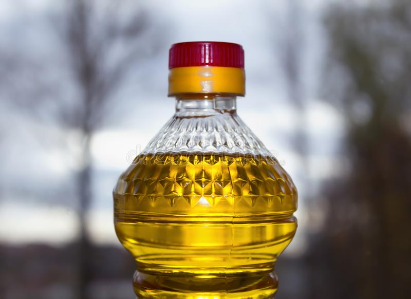 Plastic bottle with sunflower oil close up stock photography