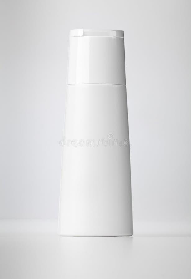 Plastic bottle on white. Plastic bottle with soap or shampoo stock photos