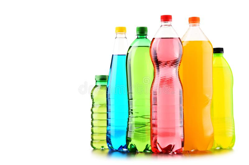 Plastic bottles of assorted carbonated soft drinks over white. Background stock images