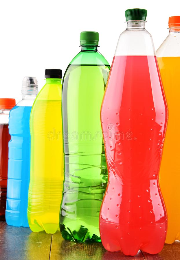 Plastic bottles of assorted carbonated soft drinks over white. Background royalty free stock photo