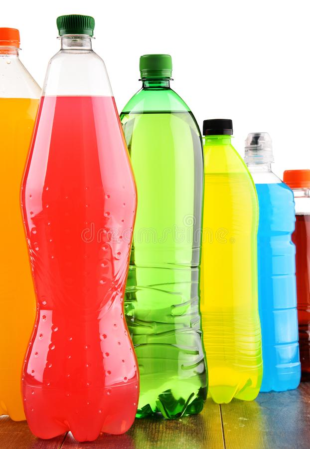 Plastic bottles of assorted carbonated soft drinks over white stock images