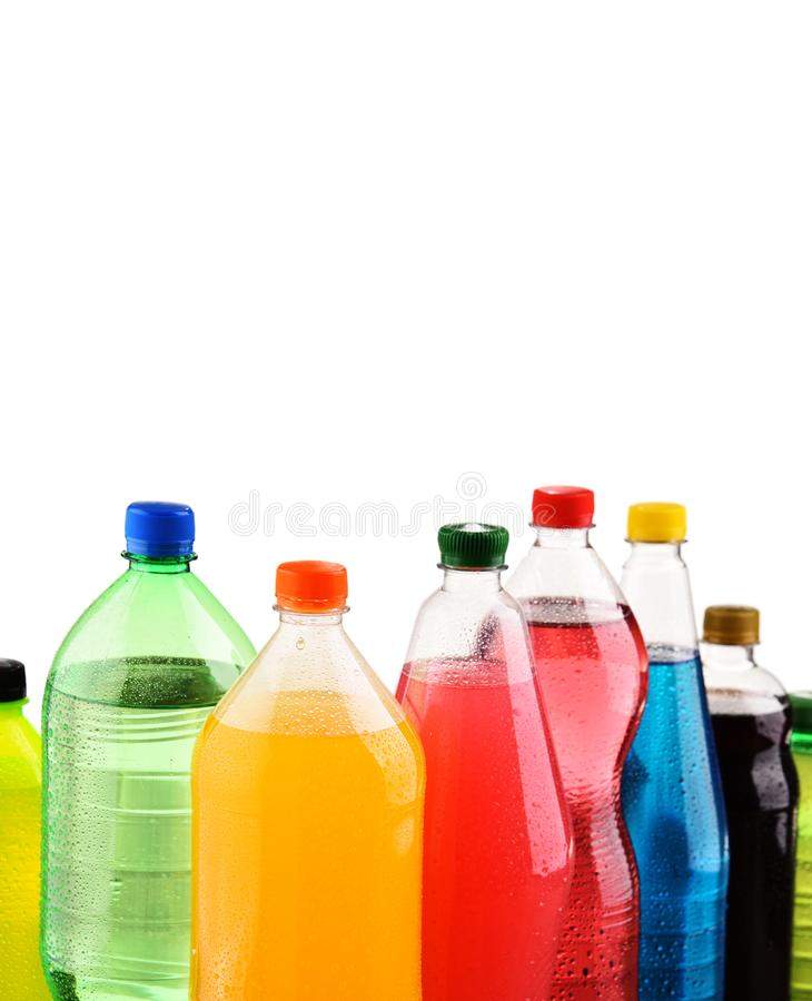 Plastic bottles of assorted carbonated soft drinks over white. Background royalty free stock image