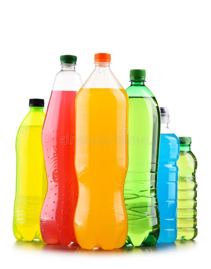 Plastic bottles of assorted carbonated soft drinks over white. Background royalty free stock photography